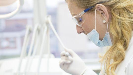 dental hygienist working on biomimetic dentistry in arizona