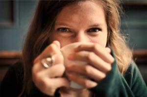 girl drinking tea - staying healthy during cold and flu season