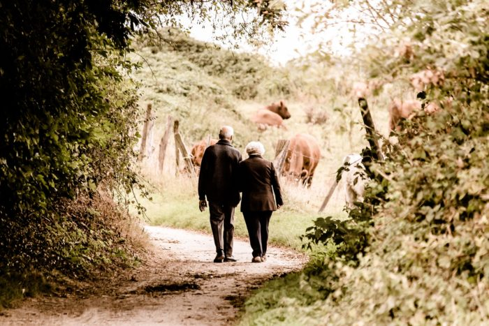 old couple walking - dental health and alzheimer's disease